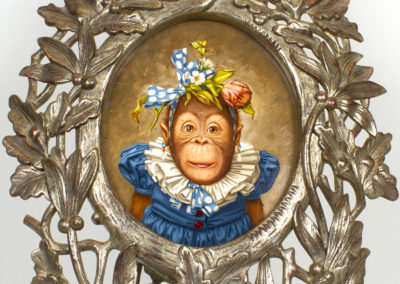 Cookie...Dressed and Ready (2014)<br>oil on canvas oval shaped, 12 x 10 inches<br>Frame museum quality, designed by the artist, hand carved, 24 karat gold leaf.